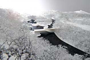 Budynek-most: hybrydowa budowla. Galeria sztuki w budynku nad rzeką. Norwegia. Źródło: BIG
